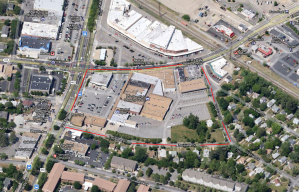 The new shopping center will replace the entire block, marked in red.